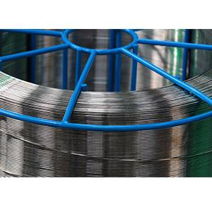 A roll of chrome silicone spring wire on blue support