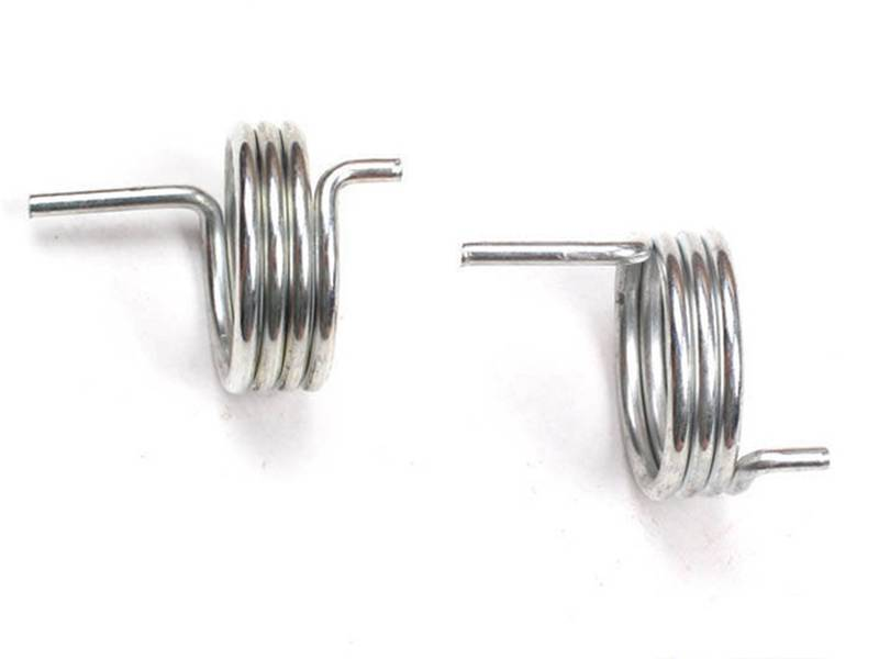 Two battery springs on white background